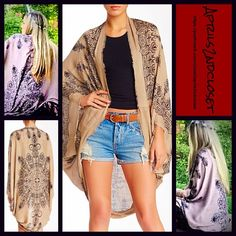 """Cape Kimono Cocoon Wrap Cardigan NEW WITH TAGS RETAIL PRICE: $68  Boho Festival Cape Kimono Cocoon  * Relaxed & Oversized Wrap Silhouette  * Beautiful henna print & frayed fringe trim  * Boho'festival feel';Incredibly lightweight for most seasons  * Cocoon like style with long wide kimono sleeves (cardigan style)  * Oversized fit; About 41.5"""" long in the back  Fabric: 100% Viscose  Color: Mocha & Black Combo   No Trades ✅Offers Considered*/Bundle Discounts✅ *Please use the blue 'offer'…"""