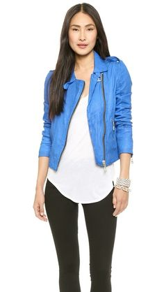 Fantastic motorcycle jacket. That bright blue leather really softens the look.