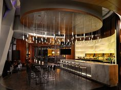 Fabricated strips of Chroma create sophisticated partitions in this exclusive club. A large lit wall feature behind the bar separates the club from the adjacent hallway.