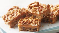 Butter Pecan Pretzel Bars- With a buttery cookie base and pecan and pretzel bits throughout, these ooey-gooey dessert bars strike Butter Pecan Pretzel Barsthe perfect balance between sweet and salty, while being totally delicious. Cookie Desserts, Cookie Bars, Easy Desserts, Cookie Recipes, Delicious Desserts, Dessert Recipes, Bar Cookies, Bar Recipes, Recipies