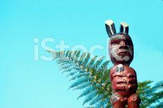 Maori Pou Figure with Ponga Fern and Sky royalty-free stock photo Sky Photos, Image Now, Ferns, Looking Up, Royalty Free Stock Photos, Holiday Decor, Photography, Maori, Photograph