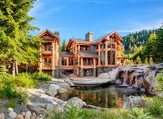 This house is retardedly too big but I love the timber structure and tin roof, but mostly the pond, waterfall and rock!