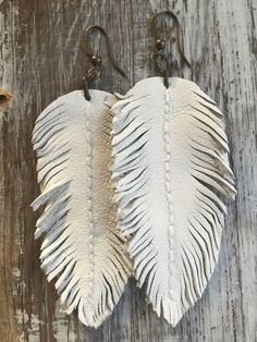 Perfect For Summer!White Leather Feather Earrings Sexy Boho chic by IslandTracie on Etsy Diy Leather Earrings, Leather Tassel, Leather Jewelry, Tassel Earrings, Leather And Lace, Dangle Earrings, White Leather, Custom Leather, Leather Tooling
