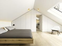 Attic loft design is one of the best space-saving solutions for tiny homes. A loft extension is a great way to add extra space, whether you crave another bedroom, bathroom or work-spaces. Turning your attic into a bedroom is a… Continue Reading → Loft Conversion Bedroom, Home, Attic Apartment, Bedroom Interior, Minimal Furniture, Bedroom Design, Loft Room, Interior Design, Attic Bedroom Designs