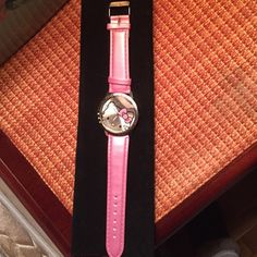 Hello kitty watch ( PRICE FIRM) NWOT hello kitty watch. Purchased never worn. Put new battery in today for selling. Water resistant. Silver bezel band is a adorable shade of pearlized bubble gum pink. Large face plus bezel has hello kitty engraved into it.  NO TRADES. NO LOWBALLERS. Total length of band is 9 inches. Will fit from 7 inches to 9 inches.  PRICE FIRM. Hello Kitty Accessories Watches