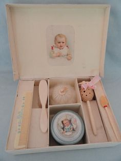 Vintage infant / baby grooming items including rattles in presentation box, circa 1920.