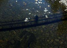 Shadow proof of being on swinging bridge