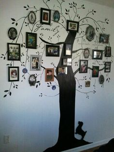Paint a tree on your wall and hang your family photos!