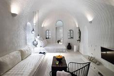 A 19th-century sea captain's home converted into a modern Santorini island cave. #white #minimalist #decor