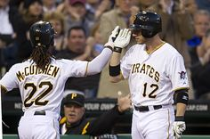 Andrew McCutchen and Clint Barmes celebrate.