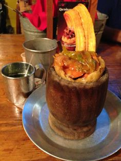 In Old San Juan, head to Raices, a local favorite where the waitstaff dresses in tradtional Puerto Rican outfits. Everyone says to try the house specialty, mofongo, served in a wooden goblet and made of your choice of meat and mashed plantains, making for a delicious and very filling meal.