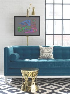 Sofa in Style - bright blue statement sofa and patterned rug designed by Jonathan Adler