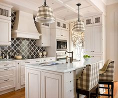 The old-world patterned backsplash combines seamlessly with the rest of the traditional kitchen and gives the space an extra dose of character.