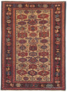 Caucasian Kuba, 3ft 8in x 5ft 0in, Late 19th Century. This tremendously spirited antique tribal rug jewel offers many attributes that delight collectors. To zoom in on the details of the deceptively simple display of tribal motifs in this spirited 19th century ivory-ground Caucasian Kuba carpet is to discover an absolutely staggering array of vegetally dyed hues. Sometimes in clusters of only four knots, a spectrum of secondary tones deftly enhances numerous shades of red and blue.