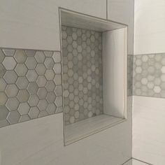 Wavy large white tile with a fab hexagon Carrara marble band.
