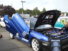 1997 Dodge car with open wing doors.