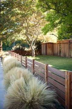 Like the tall grass, short fence (munis usually call for 3ft fence in the front yard.... but I'll have to read the code) grass border, straight lines, fencing, front yard ornamental grasses, ornamental grass, border grass