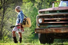 Girl, guitar, truck... There's a country song in this picture.