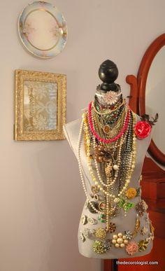 vintage dress form displaying vintage jewelry