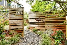 interesting fence - love the reclaimed look of this style