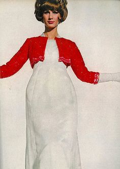 Brigitte Bauer is wearing Balenciaga's beautiful white satin princesse, with a tiny long-sleeved bolero ablaze in Spanish-red pailettes, as seen Dec. Vogue, 1962