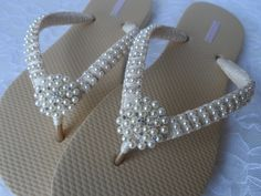 Bridal Pearls Flip Flops These Flip Flops are hand wrapped in ivory satin ribbon and embroidered with small pearls. Is adorned with ...stunning rhinestone and light ivory pearl centers. https://www.etsy.com/listing/237508283/wedge-ivory-pearls-flip-flops-wedding?ref=shop_home_active_7