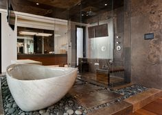 This open bathroom in a home in Las Vegas uses a pleasing mixture of stone glass and wood. [1280 x 913]