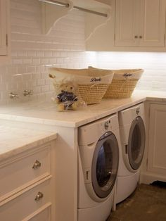 Giannetti Home - laundry room, built in clothes rod and beveled subway tiles.