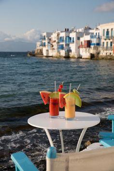 Drink Delicious Summer Cocktails while enjoying the Beauty of Mykonos, Little Venice, Mykonos #capriceofmykonos #capricebarmykonos #capricemykonos #littlevenicegreece #littlevenicemykonos #cocktailsmykonos #mykonosbar #whattodoinmykonos #placestovisitinmykonos Refreshing Summer Cocktails, Summer Drinks, Cocktail Drinks, Rice Bar, Fruit Sticks, Mykonos Greece, Summer Fruit, Fresh Fruit, Event Planning