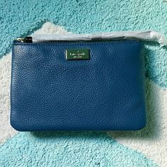 NWOT blue Kate Spade wristlet Brand new never before used blue leather Kate spade wristlet. Perfect for cards cash and change. Very chic and stylish! kate spade Bags Clutches & Wristlets