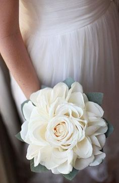 Single one of these for each bridesmaid? a handmade, white rosette made of vendela roses. It is made of one full rose head and finished with lots of rose petals to give the appearance of a giant, garden style rosette and has an eucalyptus-leaf border.