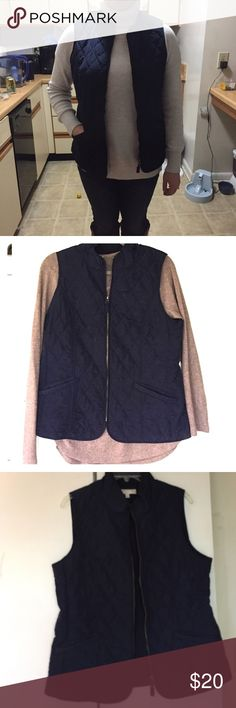 Quilted Navy Vest Classic quilted zip up vest. So cute over a sweater! Light weight but warm for layering. Would fit 8-12 with thin layer underneath, would fit 8-10 with chunky sweater under. Working front pockets Talbots Jackets & Coats Vests