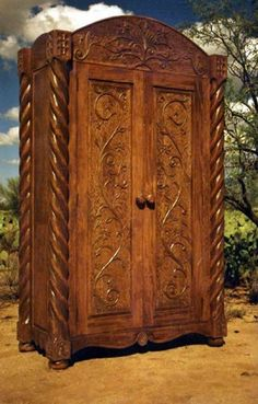 Governor armoire, custom made by Southwest Furniture & Design. ::: secret passage behind it that leads to a courtyard?