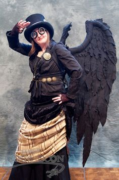 Awesome steampunk costume at Norwescon. Photo by Michael Hanscom for Norwescon. - like these wings  will work on how to make them - maybe wire some pool noodles for the support, use a dyed dropcloth for wing base . . .