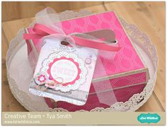 http://www.loriwhitlock.com/blog/four-compartment-cookie-box-tutorial-with-tya/