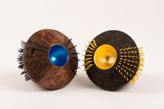 Cone of Gold, ebonised and textured burr oak with 23c gold leaf and dyed yellow spikes, 2008;  NMIDF:2009.4 and Cone of Colour, burr elm with blue pearlescent ink and blue dyed spikes, 2008