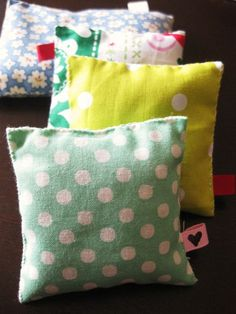 DIY sachet pillows - plus, I like how they used a fabric tag that was looped
