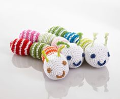 This loveable and fun, cotton Pebble caterpillar rattle in bright blue and green stripes makes a perfect companion and its soothing rattle sound is stimulating for baby.Handmade and fair trade. Suitable from birth.  Machine washable. Made from 100%