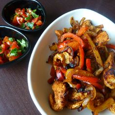 Paleo Chicken Fajitas--- Combine peppers, onion, and chicken all cut in long strips. Sprinkle with paprika and cumin, squeeze the juice of one lime over top and stir in a little olive oil. Cook in skillet, then top with fresh salsa and guacamole