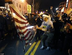 Unrest: Some of the groups Soros funded came up with slogans and social media campaigns to...