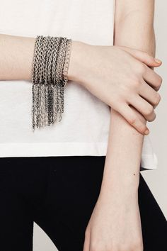 This chain fringe cuff bracelet is such a statement piece.