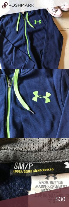Under armour full zip hoodie Under armour full zip hoodie. Navy blue with electric green details in excellent used condition. No stains tears or snags. Size men's small Under Armour Jackets & Coats
