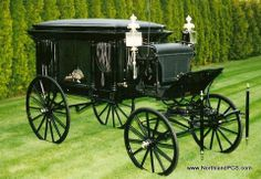 This 1900 horse-drawn is typical of the solemnity of hearses of that era.