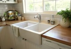 Farmhouse sink, wood counter, cabinets, big window