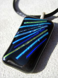 Peacock colors. Sleek stripes dichroic glass pendant silk necklace. $14.99, via Etsy.