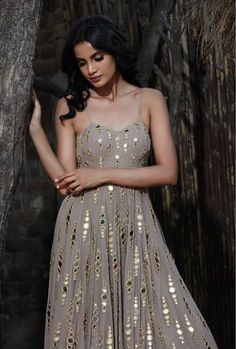 The taupe dainty mirror gradation kalidar ensemble defines perfection. A classic silhouette which is feminine, classy and fun is paired… Party Wear Indian Dresses, Designer Party Wear Dresses, Indian Gowns Dresses, Kurti Designs Party Wear, Dress Indian Style, Indian Designer Outfits, Indian Wedding Outfits, Bridal Outfits, Unique Dresses