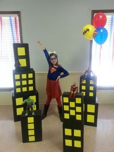 Super hero party decorations. Spray paint boxes and cut windows out of poster board. This project cost less than $7 to make. Easy and was a big hit!