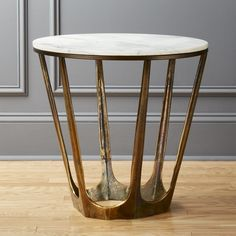 Cast aluminum base is polished, brass-plated and rainbow-shaded to create a perfectly-aged effect. Warmer and bronzier than solid brass and beautifully textured, White Marble Side Table's base opens from the floor up. Marble Gold, White Marble, Modern Side Table, Modern Coffee Tables, Wire Side Table, Side Tables, Marble Nightstand, Marble Top End Tables, Messing
