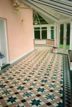 Stunning Victorian geometric tiled floor in this superb conservatory