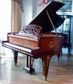 One Grand Piano- in my home & teaching my kids songs for their Mom , while she's watching feeling deeply in love